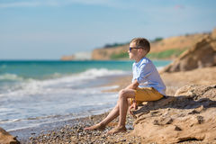 Fashion boy on the beach Royalty Free Stock Image