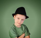 Fashion Boy with Hat on Green Background Royalty Free Stock Image