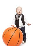 Fashion boy playing whit a huge basketball Royalty Free Stock Photo