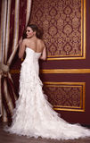 Fashion bride with blond hair in luxurious dress posing in interior Royalty Free Stock Images
