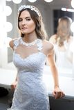 Fashion bride in a studio near the dressing room Royalty Free Stock Photos
