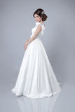 Fashion bride woman posing in wedding dress isolated on gray bac Royalty Free Stock Image