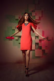 Fashion bright photo of a woman in red dress Royalty Free Stock Photography