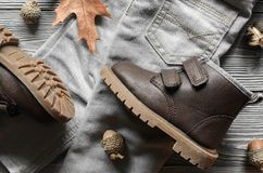Fashion brown leather kids shoes, denim pants and accessories. a. Utumn concept Stock Images