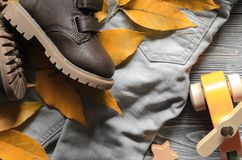 Fashion brown leather kids shoes, denim pants and accessories. a. Utumn concept Royalty Free Stock Photos