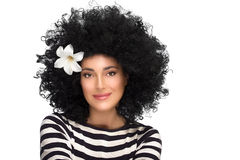 Fashion Brunette Girl with Flower in Curly Afro Hairstyle Royalty Free Stock Images