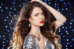Fashion brunette girl with long wavy hair, beauty makeup, luxury Royalty Free Stock Photography