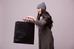 Fashion brunette girl look in shopping bag Stock Image
