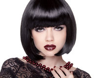 Fashion Brunette Girl model with Black bob hairstyle. Lady vamp. Royalty Free Stock Images