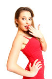 Fashion brunette girl in red dress isolated on white background Royalty Free Stock Images