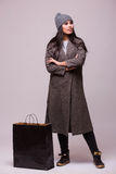 Fashion brunette girl with shopping bag Royalty Free Stock Photo