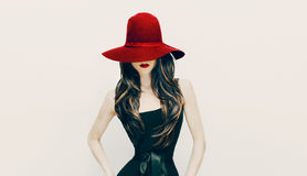 Fashion brunette lady in red hat and red lips on white backgroun Stock Photo