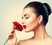 Fashion brunette model girl with red rose Stock Photos