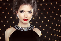 Fashion Brunette Model Portrait. Jewelry and Hairstyle. Elegant Royalty Free Stock Photos