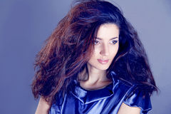 Fashion Brunette over blue . Beautiful Makeup Royalty Free Stock Photography