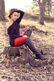 Fashion brunette posing in the park Stock Photos