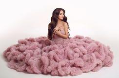 Fashion brunette pretty woman in gorgeous long pink dress posing Royalty Free Stock Photos