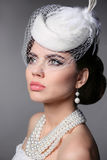 Fashion Brunette Retro Model Portrait. Pearls Jewelry and Hairst Stock Photography