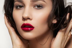 Fashion brunette with sexy lip make-up, clean skin Stock Photo