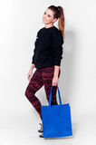 Fashion brunette woman with bag stock image