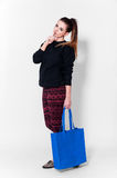 Fashion brunette woman with bag Stock Photos