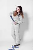 Fashion brunette woman. Beautiful brunette smiling, fashion woman in sports clothing Stock Image