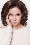 Fashion brunette woman with brown curly hair girl with perfect skin and makeup. Beauty Model retro. Beauty and fashion girl. stylish woman. curly hairstyle Royalty Free Stock Images