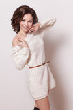 Fashion brunette woman with brown curly hair girl with perfect skin and makeup. Beauty Model retro Stock Image