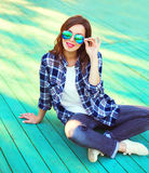 Fashion brunette woman in casual checkered shirt. And sunglasses Royalty Free Stock Photography