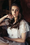 Fashion brunette woman in dress in  vintage location Royalty Free Stock Photo