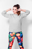 Fashion brunette woman in leggings Stock Images