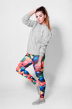 Fashion brunette woman in leggings Royalty Free Stock Images