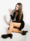 Fashion business beautiful young women in a little black dress with accessories, holding an empty wine glass royalty free stock photos