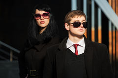 Fashion business couple against office building Royalty Free Stock Image