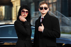 Fashion business couple against office building Stock Photos