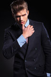 Fashion business man in a provocative pose Royalty Free Stock Images