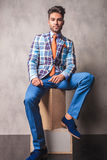 Fashion business man sitting on wood boxes Stock Photography