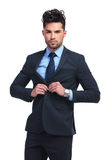 Fashion business man un buttoning his coat Royalty Free Stock Image