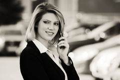 Fashion business woman calling on the cell phone outdoor Royalty Free Stock Photos