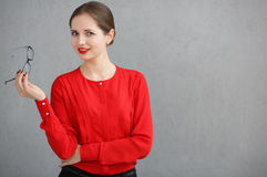 Fashion business woman with a red shirt and glasses portrait, holding sunglasses in his hand Stock Photography