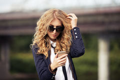 Fashion business woman in sunglasses calling on mobile phone Royalty Free Stock Photo