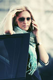 Fashion business woman in sunglasses calling on phone next to car Royalty Free Stock Photos