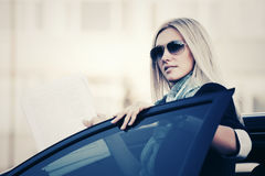 Fashion business woman in sunglasses by car Stock Photos