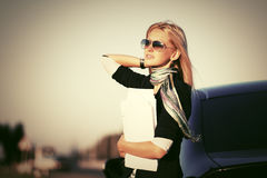 Fashion business woman in sunglasses next to her car Royalty Free Stock Photography