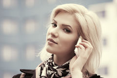 Fashion business woman talking on cell phone in city street. Fashion business woman talking on cell phone walking in city street Royalty Free Stock Image
