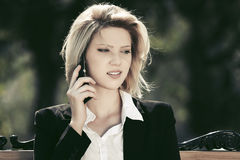 Fashion business woman talking on cell phone outdoor Stock Photography