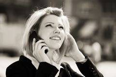 Fashion business woman talking on mobile phone outdoor Royalty Free Stock Photo