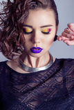 Fashion capture beautiful sexy girl with bright makeup, big full lips with purple lipstick, beautiful hair. Photography makeup Stock Image