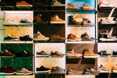 Fashion Casual Male Sneakers On Shelves In Store Of Shopping Cen. Ter Royalty Free Stock Photo