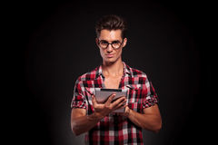 Fashion casual man with tablet Stock Image